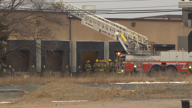 Fire crews work to determine cause of blaze at local textile business