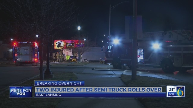 Two injured after semi truck overturns