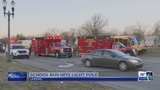 2 students checked for injuries after Lansing school bus crash
